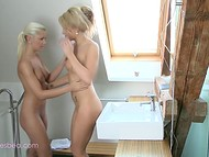 Two magnificent blondes caressed each other's bodies in the bathroom