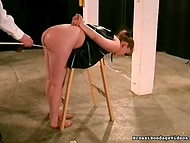 Master spanks ruddy ass of the dominated girl using different lashes