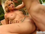 Golden-haired chick got fucked from both ends by two raunchy male beasts outdoors