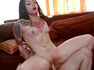 Brunette with tattooed body gets a lot of pleasure riding dude's vigorous pecker