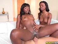 Interracial sex scene with participation of two Ebony chicks hopping on penis of white playboy