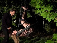 Pervert ties obedient blonde to blooming chestnut at midnight and mercilessly deepthroats her