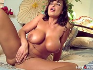 Charming big-boobied Lisa Ann masturbates her trimmed peach with small vibrator