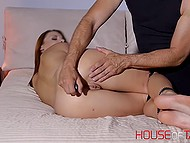 Alluring lassie got hands and feet tied before having both holes stimulated with adult toys