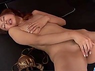 After taking off golden swimsuit, Asian inserted compact vibrator in hairy pussy