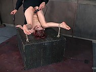 Tied redhead gets punished by whip, micro vibrator in her cunt and a big black dildo