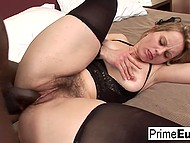 Dame caressed hole with fingers then let black dick enter deep inside hairy vagina