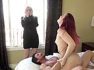 Sexy red-haired girl has sex with handy fucker in bedroom in front of blonde MILF