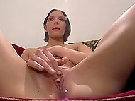 Teenage Danish girl with short haircut and long legs uses favorite dildo in front of camera
