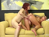 Big-breasted blonde and girlfriend with red hair fool around with glass dildos and fingers