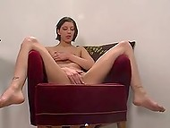 Dark-haired Danish girl throws some naughty glances in lens working pussy out with dildo