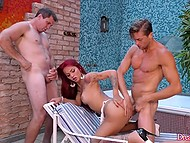 Red-haired shemale with tattoos on curvy body is the protagonist of outdoor anal threesome