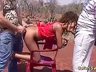 Two tourists fuck Ebony hooker from both ends under rays of scorching African sun