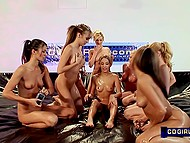 Nine playful teen girls with tiny sexy bodies get rid of clothes and rub each other with oil