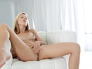 Adorable blonde unhurriedly massages own shaved snatch alone in living room