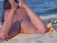 Croatian chick lies naked on beach unaware of voyeur who checks her pussy and ass