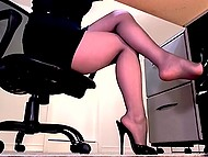 During work naughty secretary gladly demonstrates legs in pantyhose on hidden camera