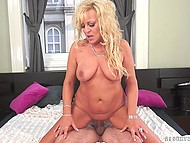 Curly mature blonde with tanned body is fucked in reverse cowgirl and spoons sex positions