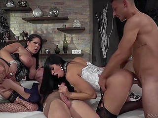 Luxurious brunettes in sexy stockings and two buddies have wonderful group sex together