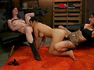 Chicks torment Asian girlfriend with toys and make her give them cunnilingus in BDSM cellar