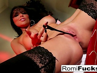 Black-haired pornstar Romi Rain stuffs shaved pussy with lingerie to feel something new