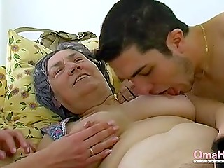Old woman presents blowjob to young dude and his girlfriend brings her dildo after it