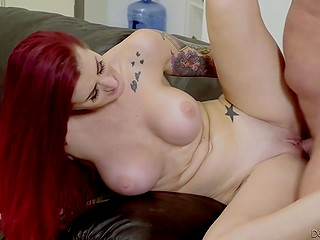 Red-haired lady with massive breasts carefully moistened dick before the long-awaited fuck on couch