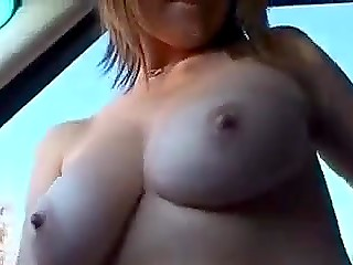 Attractive girl agreed to show guy her perfect natural boobs and trimmed pussy right in car