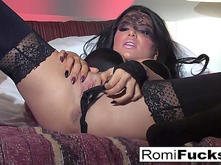 Fabulous brunette Romi Rain seductively eats ice cream and takes part in a photo session