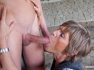 Naughty granny dominates over naked boy under bridge and even sucks his fuckstick like pro slut
