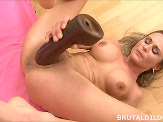 Sexy wench with delectable tits successfully replaces black cock with gigantic fat dildo
