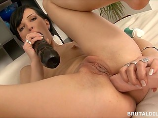 Solo video where brunette woman with small tits stretches pussy and anus with big dildos