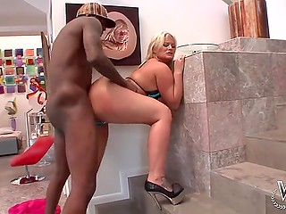 Ebony stallion quickly realizes that blonde's gigantic butt is perfect for anal stretching