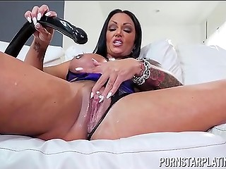 Super busty brunette MILF with pierced nipples wouldn't mind replacing long black dildo with cock of the same color