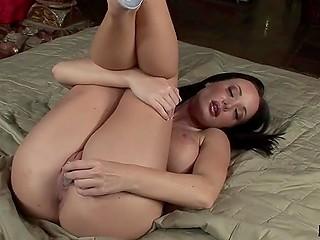 Solo scene where full-bosomed brunette Melissa Lauren from France makes pussy happy
