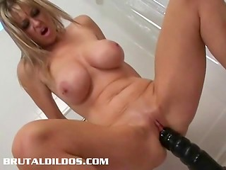 Smooth twat of busty diva with long legs is ready for adventures with huge black dildo