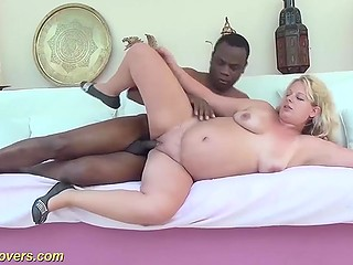 Excited pregnant blonde observes black neighbor peeping on her and beckons man to fuck her