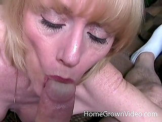 Mature blonde with round boobs interrupts phone conversation to give insistent lover nice blowjob