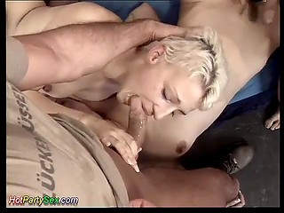 Blonde in stockings and her girlfriend take part in intense group sex with several excited studs