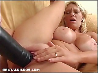 Blonde pornstar with impressive breasts Charlee Chase stuffs shaved pussy with huge black dildo