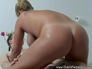 Blonde Dutch masseuse with juicy boobs helps buddy release man juice on her impressive body