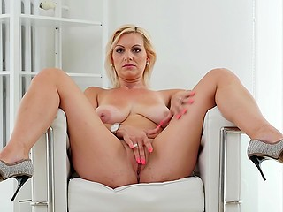 Tanned blonde woman with splendid natural chest with pleasure masturbates on camera