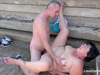 Experienced fatty seduces stranger to have quick fuck outdoors behind building materials