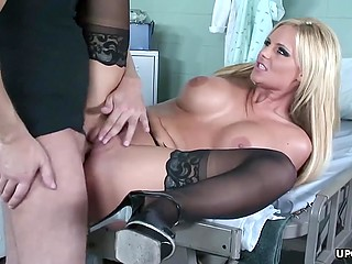 Busty woman in stockings forgets about pain in buttocks after doctor fucks shaved vagina