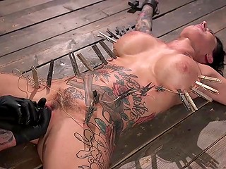 A lot of interesting things are waiting for tattooed brunette Lily Lane with big tits in BDSM scene