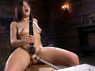 Asian girl is on her way to bright orgasm that will be reached thanks to fucking machine and powerful vibrator
