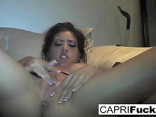 Brave female Capri Cavanni in a black bra does it on her own flirting with men on the other side of screen