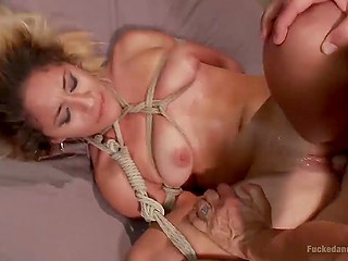 First-time BDSM-fucking for blonde is so pleasurable that she moans loud thus making guy cum on her face