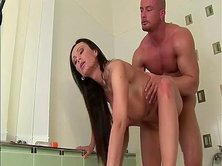 Brunette MILF with awesome big tits sees guy's boner and practices sex in bathroom