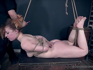Submissive redhead broadens sexual horizons by experiencing BDSM domination in special cellar